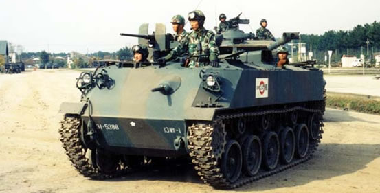 The Type SU 60 APC, you can see the muzzle of a Type 61 tank in the background