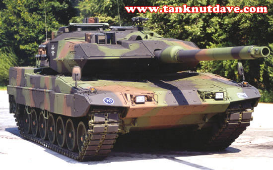 A German Leopard 2A6, the hulls added modular armour containing a composition of ceramics/tiles is visable as it ends over the lip of the mantlet and you can see a visable change in the depth to the original hull front