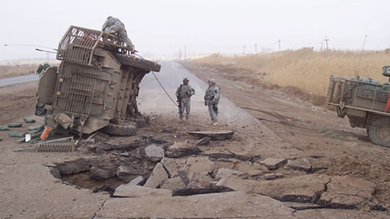 A Stryker flipped over from the force of a buried IED.